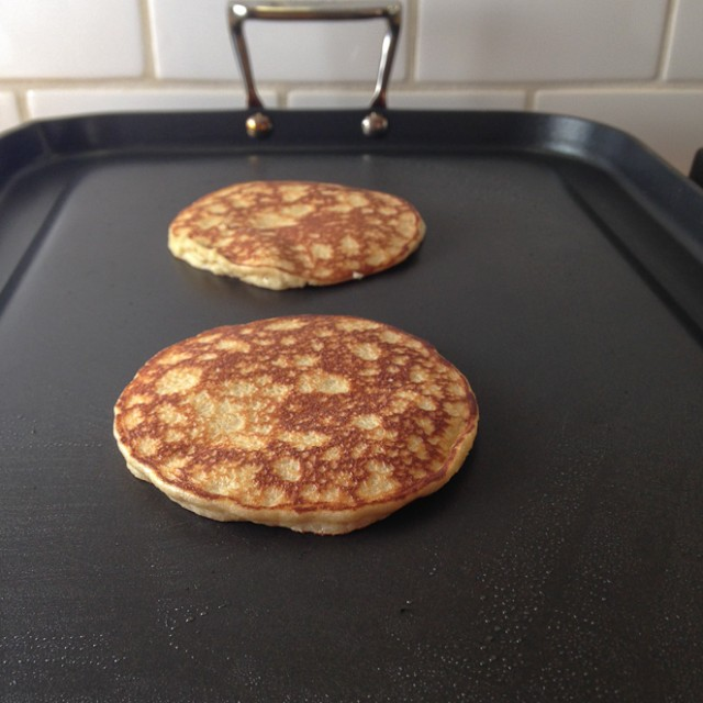 almond flour pancakes cooked on the griddle