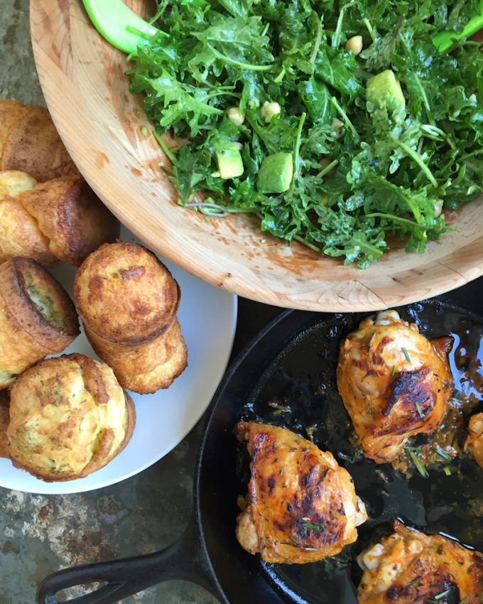 baby kale salad with oven roasted sriracha chicken thighs and rosemary and sea salt popvers_